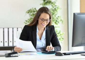 bookkeeper-smiling-at-desk